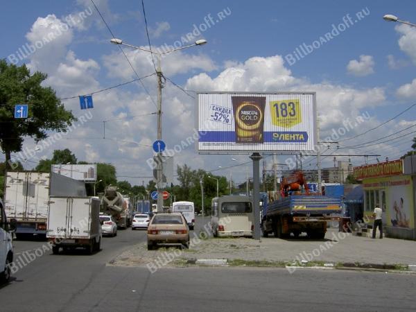 Менжинского ул. 2 (через дорогу в конце дома по ходу движения)